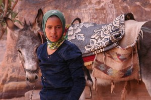 Girl in Jordan with donkey