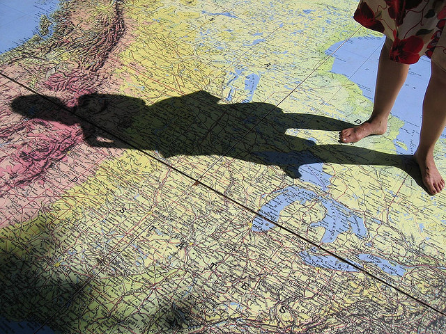 standing on a world map