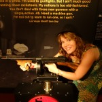 girl posing with machine gun inside the mob museum in las vegas