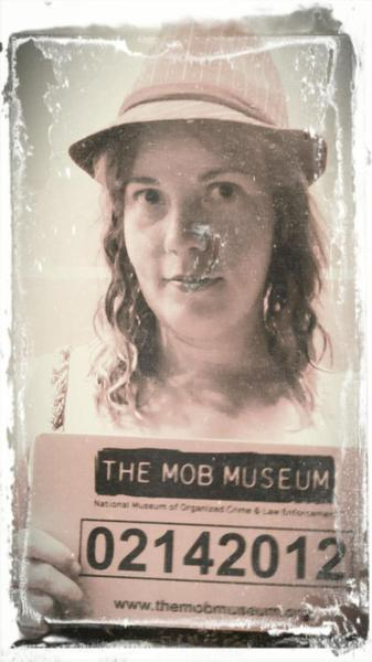 girl posing for fake mug shot from mob museum las vegas