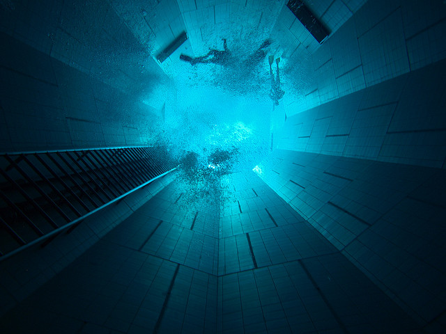 scuba divers at the bottom of the nemo 33 in belgium