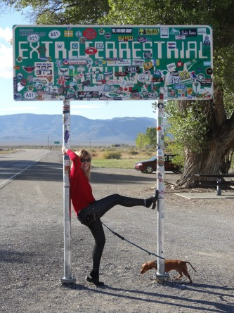 Reannon and dog posing infront of the extraterrestrial highway