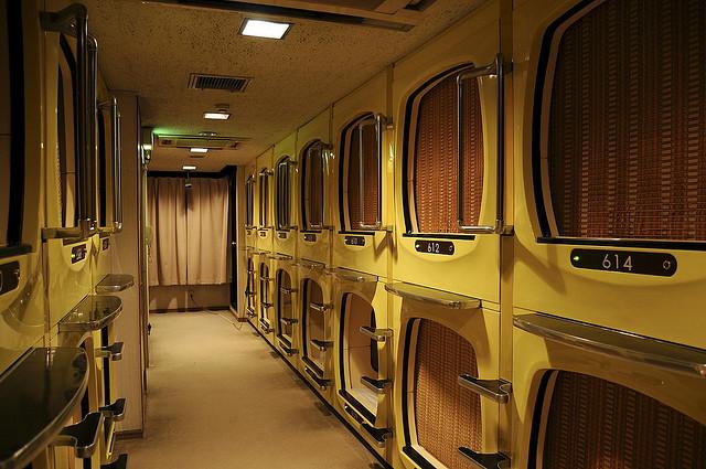 hallway of capsule hotel rooms in japan