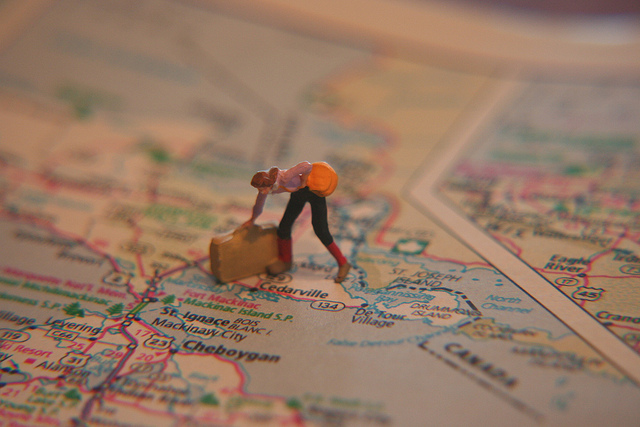 girl, suitcase and map