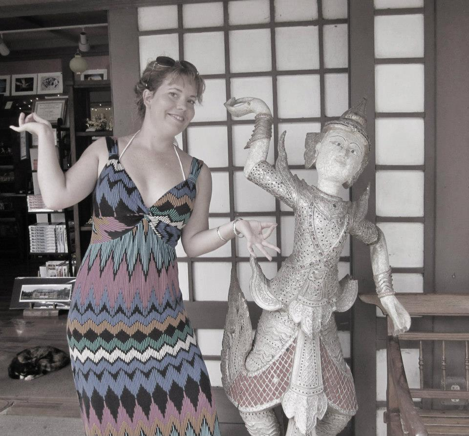 Reannon posing next to Buddhist statue at Temple Valley on Oahu in Hawaii