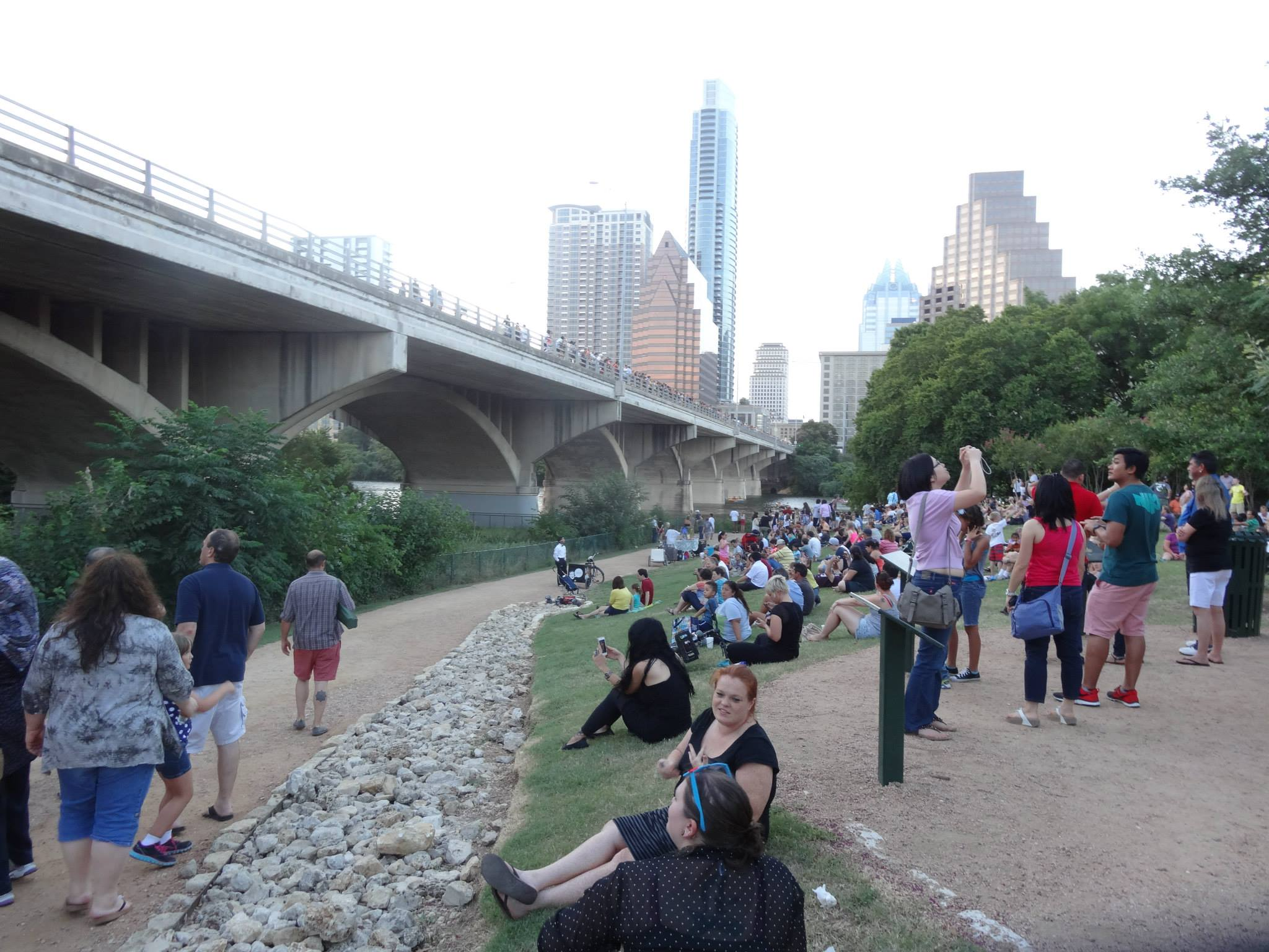 people gathered to watch the bats under the South Congress bridge in Austin Texas