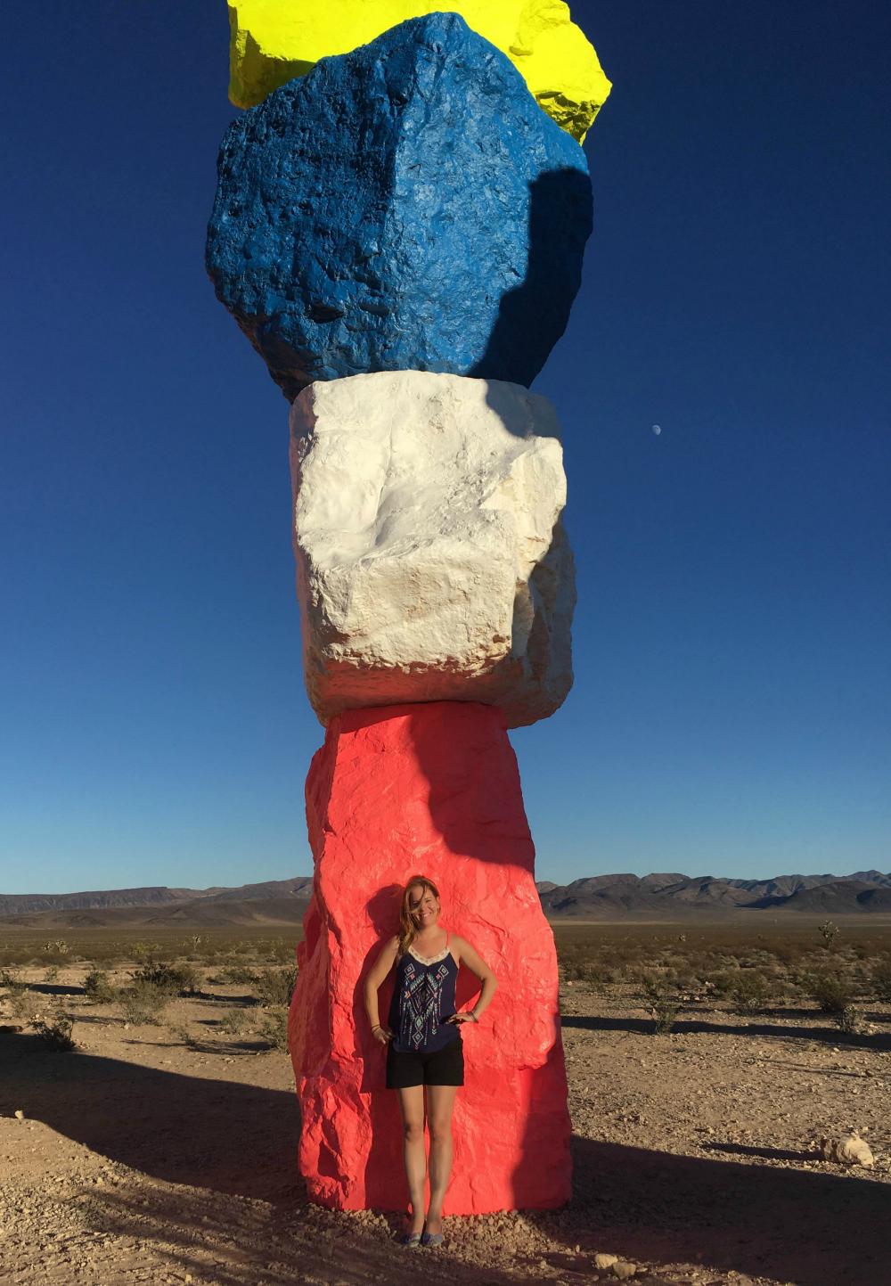Standing in front of Seven Magic Mountains Rock Tower